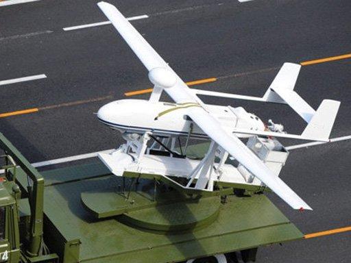 该无人机采用后推式双尾撑结构布局,好处是后置发动机驱动的螺旋桨